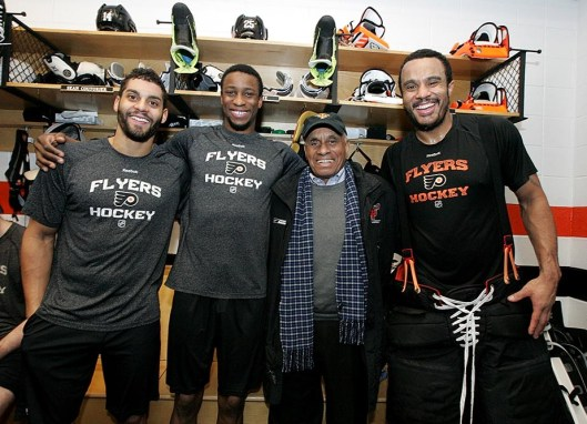 Diversity on display in Flyers' locker room. Left to right: Pierre-Edouard Bellemare, Wayne Simmonds, Willie O'Ree and Ray Emery (Photo/Philadelphia Flyers).