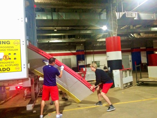 The Washington Capitals' old dasherboards get loaded onto a trailer at Verizon Center. Final destination: The Fort Dupont Ice Arena.