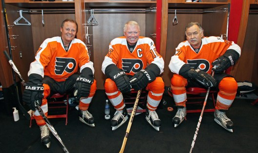 Reggie Leach (right to left) reunites with Bob Clarke and Bill Barber for an alumni game before the 2012 NHL Bridgestone Winter Classic in Philadelphia (Photo/ by Len Redkoles/NHLI via Getty Images)