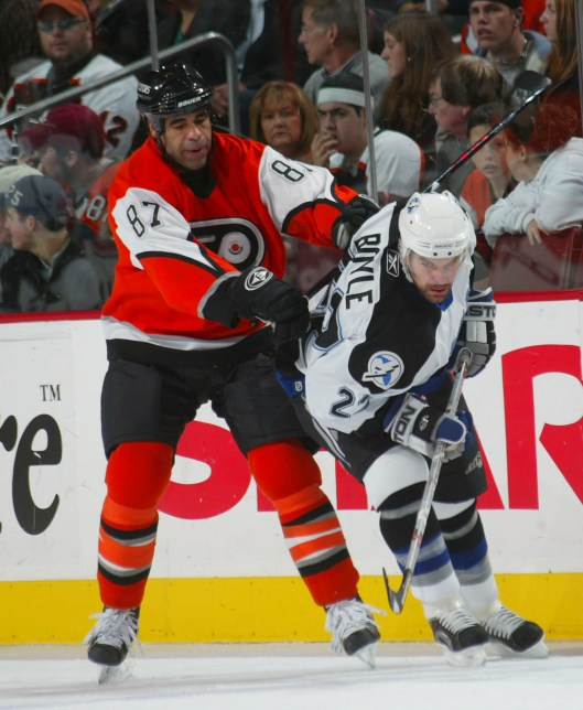 Donald Brashear, left, played for five NHL teams, including the Philadelphia Flyers (Photo/Bruce Bennett/Getty Images via Philadelphia Flyers).