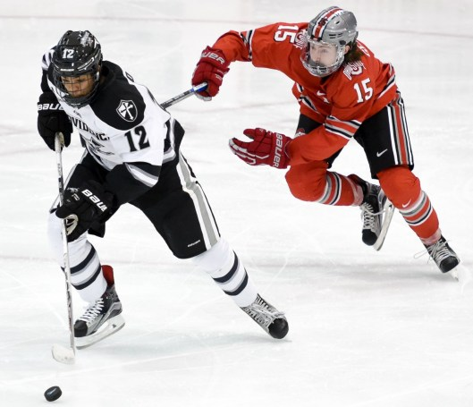 Providence College forward Erik Foley outskates Ohio State University player for the puck.