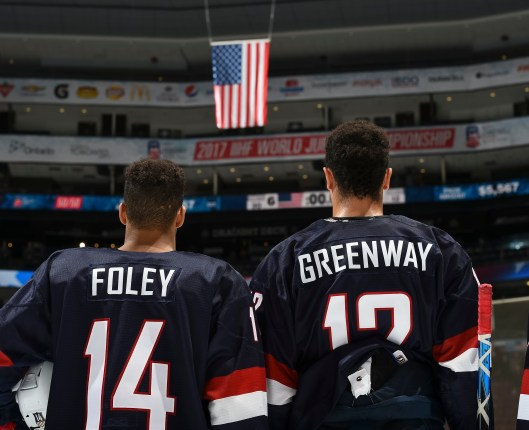 Team USA's Erik Foley, left, and Jordan Greenway stand during the playing of  U.S. national anthem during preliminary round action at the 2017 IIHF World Junior Championship. (Photo/ Matt Zambonin/HHOF-IIHF Images).