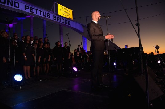 SELMA, AL - JANUARY 18: EDITORIAL USE ONLY- Common (L) and John Legend (R) during a special live performance on the Edmund Pettus Bridge on January 18, 2015 in Selma, Alabama. (Photo by Rick Diamond/Getty Images for Paramount Pictures) *** Local Caption *** Common; John Legend