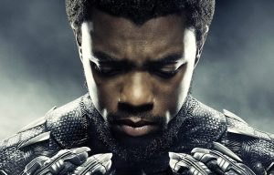 T'Challa, in his Black Panther suit sans mask, studies his claws pensively. He's weighing the responsibility now on his shoulders.