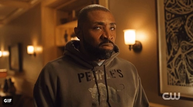 Jefferson Pierce (Cress Williams) wearing the dark grey People's Free Food Program hoodie.