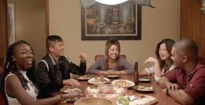 "The cast of ""Do Better"" sit around the dining room table, laughing and eating dumplings and drinking beer."