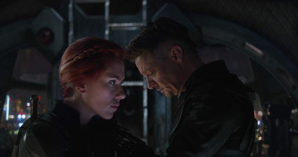 Hawkeye pensive, has his hand on Black Widow's shoulder.