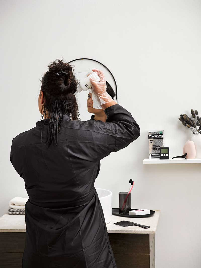 Starting from the bottom, apply Colourless Hair Colour Remover to the areas of hair colour you are wishing to remove, ensuring that the hair is saturated.