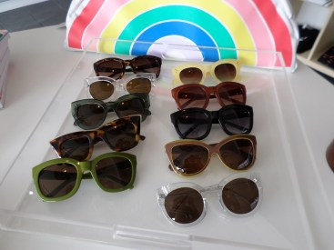 A display of the many styles of sunglasses.