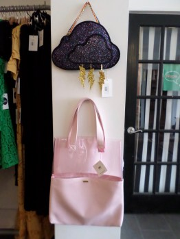 Two very unique hand bags ranging from a sparkly cloud to a pink clear bag.