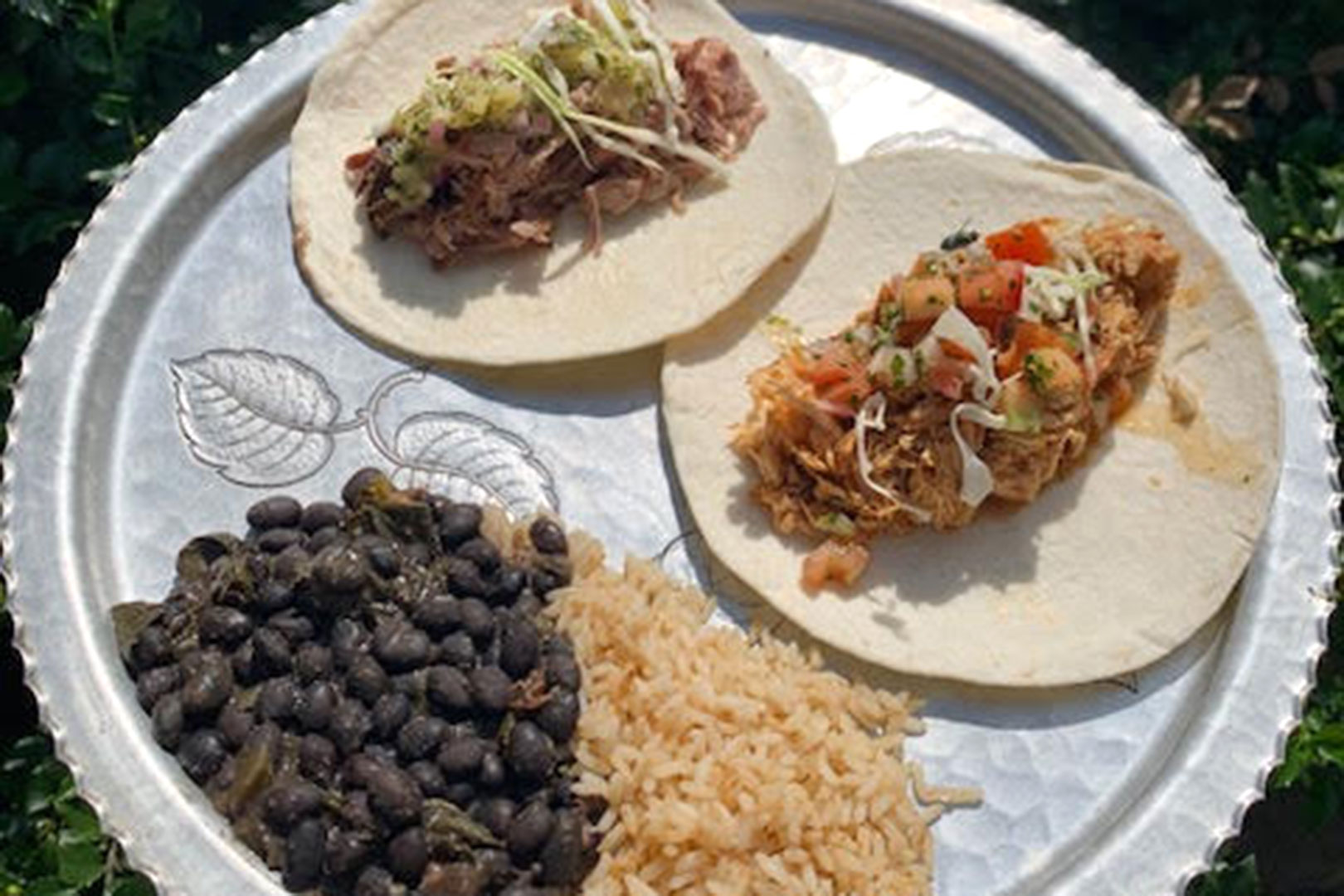 Chicken and bean tostadas with black beans and Mexican rice.