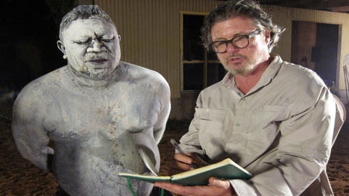 Rupert Manmurulu, known as The Giant, writes a poem with host Bob Holman during the Coroboree ceremony on Goulburn Island, NT, Australia.