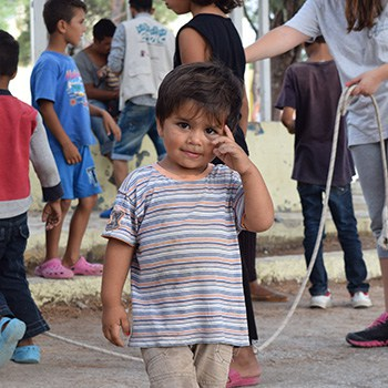 A little boy is pictured at a refugee camp in Greece.