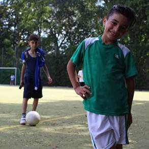 Children living at a refugee shelter in Germany got a time-out for a fun soccer tournament thanks to Washington and Lee students Melina Knabe and Matt Carl.