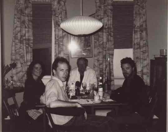 Ward Briggs '67 (second from left) is pictured at a dinner party with poet and novelist James Dickey (center) in the 1970s. Photo courtesy Ward Briggs.