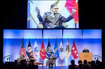 Supreme Court Justice Ruth Bader Ginsburg on stage at VMI with her biographers, Wendy Williams and Mary Hartnett, and VMI's General Peay.