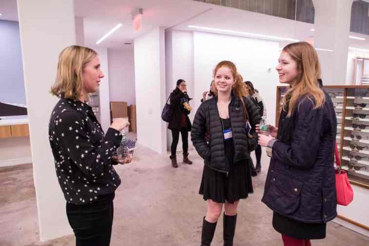 W&L students talk with Huntley Rodes '07 (left) at Warby Parker headquarters in New York.