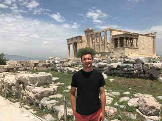 Josh Fox poses in Greece, where he spent several weeks during summer 2017 conducting geology research with Prof. Jeffrey Rahl.