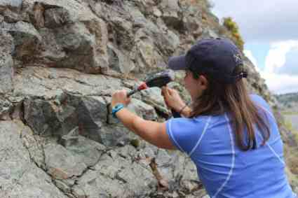 Chantal Iosso obtains a rock sample in Crete, Greece, for ongoing geology research at W&L.