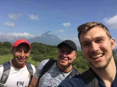 Matt Lubas '18 (right) shoots a selfie with new friends during a prosthetics clinic hike.