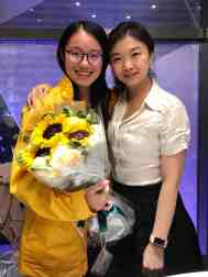 Laura Wang (left) poses with her project manager at Shell, where she interned in marketing.