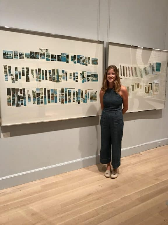 Dotterer poses in front of some work by New York-based artist Taryn Simon, with whom she interned for the summer.