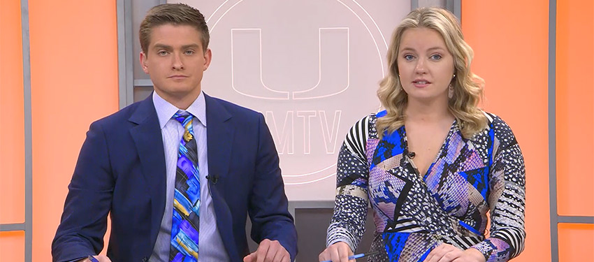 Anchors Dave Downey (left) and Grace Smith (right) introduce the top story during an episode of UMTV's NewsVision.