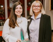 Julia Lynch, left, holds the Julia Burke Award for Character and Excellence. Photo courtesy of Julia Lynch.