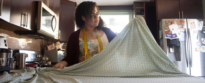 Lorena Lopez measures fabric for face masks to prevent the spread of COVID-19. Photo courtesy of Lorena Lopez.