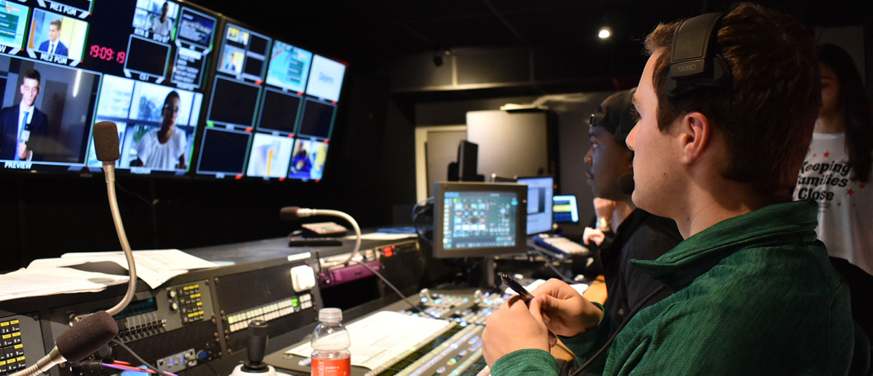 Ben Ezzy in the control room for UMTV. Photo courtesy of Ben Ezzy.