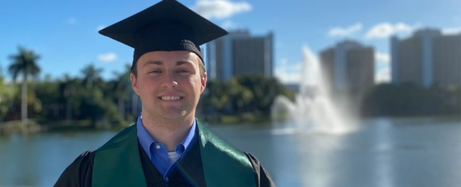 Ben Ezzy dons his graduation cap for a photo on the Coral Gables campus. Photo courtesy of Ben Ezzy.