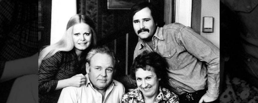 """Photo of the cast of the television program """"All in the Family."""" Standing are Sally Struthers (Gloria) and Rob Reiner (Michael); seated are Archie (Carroll O'Connor) and Edith (Jean Stapleton). Photo: CBS Television"""