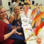 Wine and flowers are a fun combination in this painting class