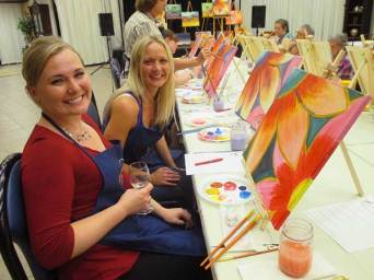 Wine and flowers are a fun combination in this paint and sip class