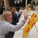 Sunflowers bring smile to painter