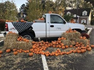 Powder Springs Truck decorated for Fall with Pumpkins and Hay Bales
