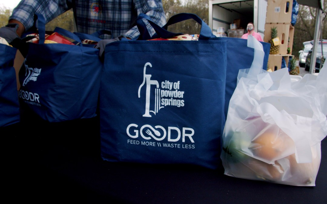 Grocery bags full of groceries on table ready for distribution