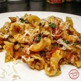 Hearty pasta with sausage and tomatoes recipe.