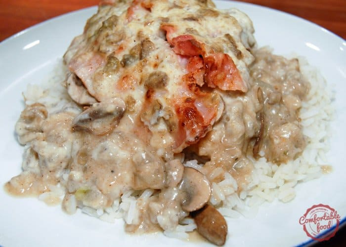 Succulent chicken breasts smothered with mushrooms and bacon.