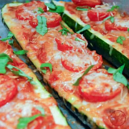 Super easy, low carb zucchini pizza boat recipe.