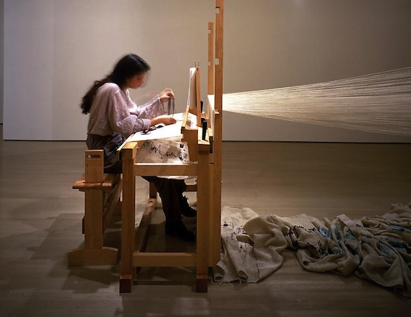 "Janine Antoni, weaving during her performance of ""Slumber""."