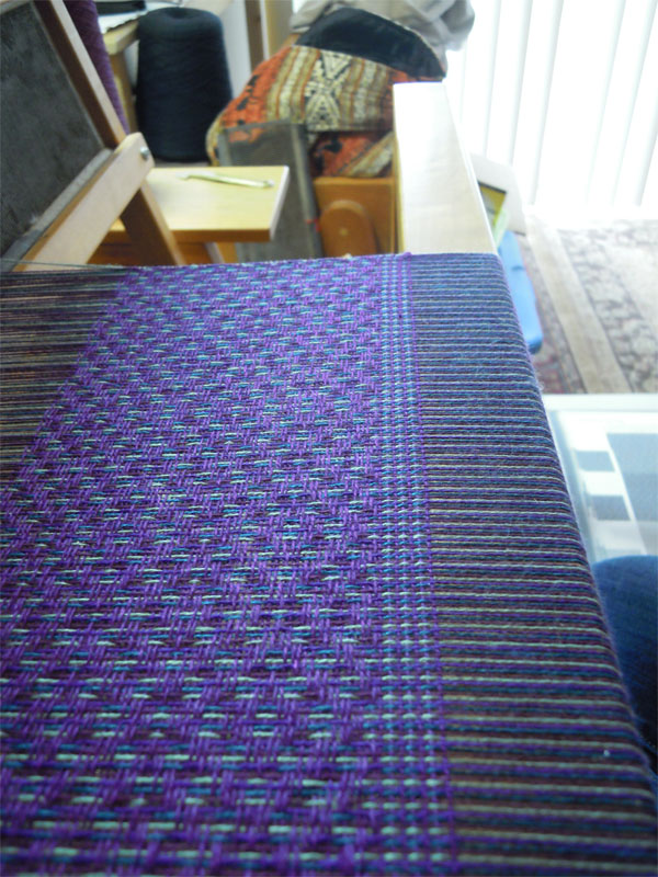 The first color variation off of the warp was too muddied because the purples were too close to each other. It was difficult to see the pattern. This was woven in an advancing twill pattern.