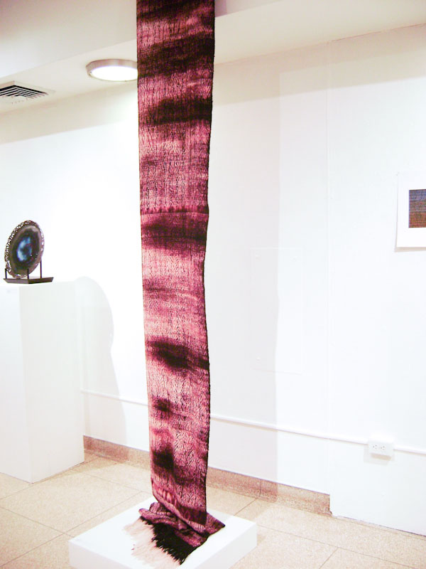 The same weaving on display in an exhibition of student work.