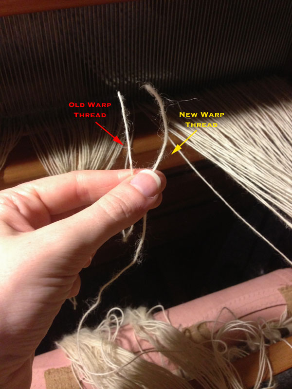 Here are the two threads I will be tying together! The new warp will be marked in yellow and the old warp marked in red.