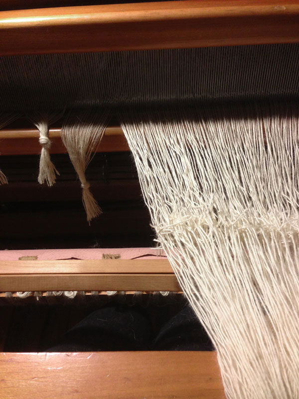 About 215 ends in the tying of a new warp to the old warp. Practice makes perfect!