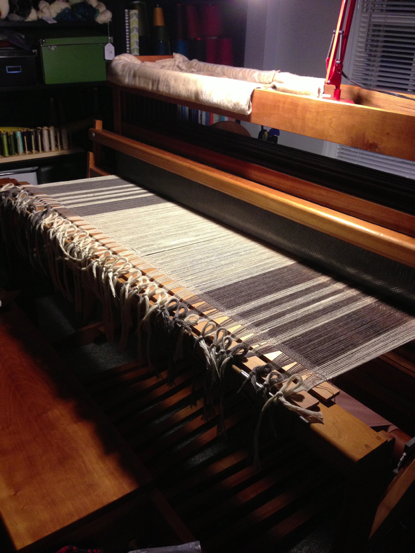 Setting up a set of blankets on the loom, everything around and on the loom is clean and orderly- making it easier to focus.