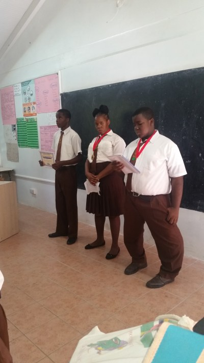 Members of the drama group giving a report