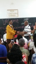 Dontae receiving his cheque