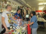 Kellam and Kevin chatting with a customer.