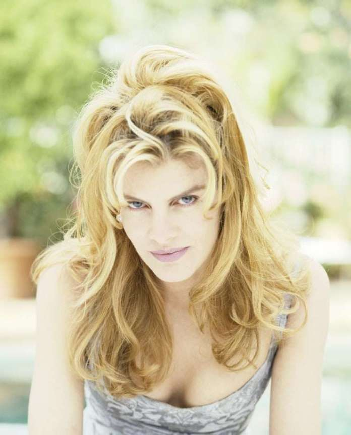 Rene Russo sexy look